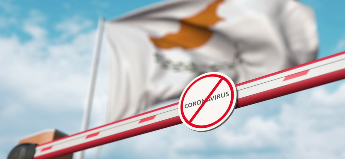 Closing boom barrier with STOP CORONAVIRUS sign against the Cypriot flag. Quarantine in Cyprus. 3D rendering