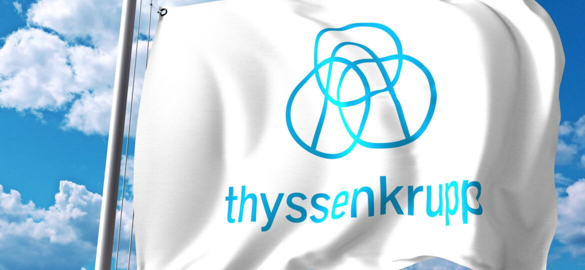 Waving flag with ThyssenKrupp logo against clouds and sky.